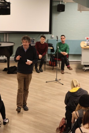 Mark Fisher in an animated discussion with the students as Jake and Carl watch
